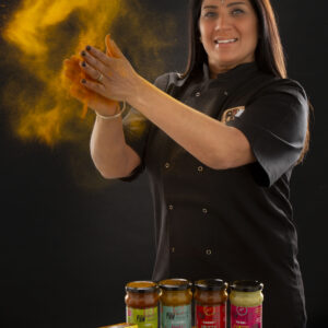 Mindi Keane with her range of  Mama Nagi's  exotic sauces and pastes.